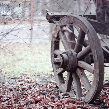 Brown Wooden Wheel on Land during Daytime