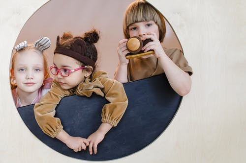 Children Peeking on a Circular Window