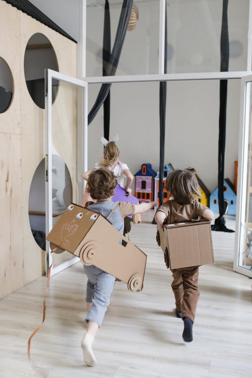 Children Running with a DIY Cardboard Box Costume