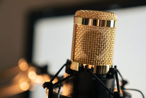 Gold Condenser Microphone on Black Stand