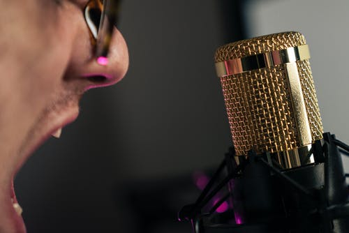 Person Singing in Front of Microphone