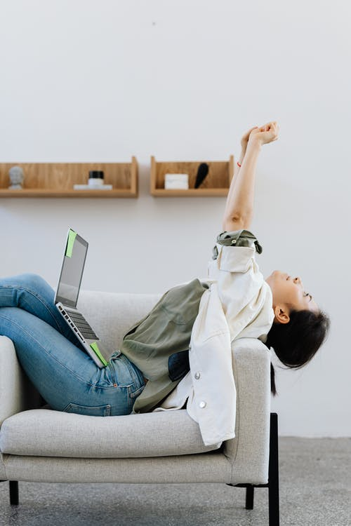 Woman Stretching Her Arms While Working