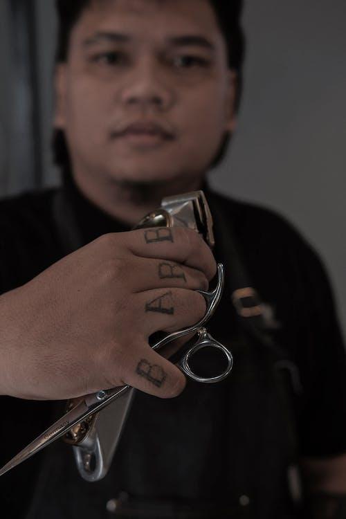 Man in Black Shirt Holding Silver Padlock