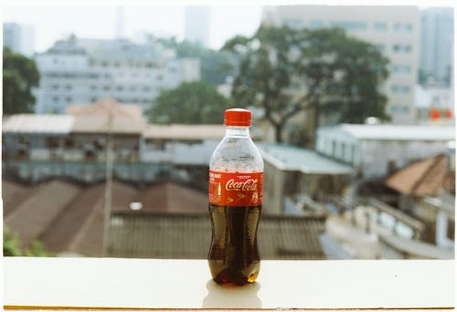 Botte of Soda by the Window