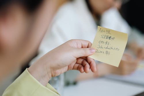 Person Holding Post It Paper