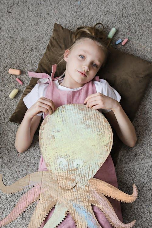 Girl Holding an Octopus Cutout