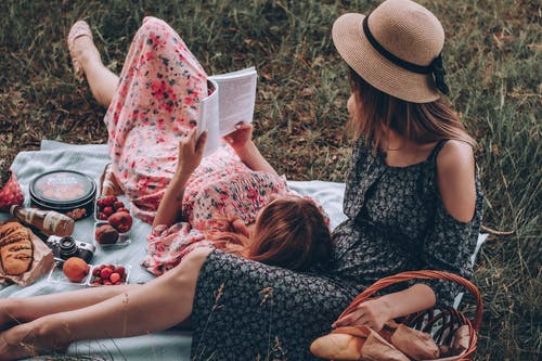 Women Reading Book Together