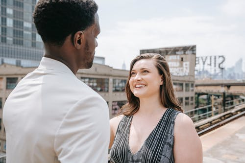 Woman Happily Looking at the Man's Face