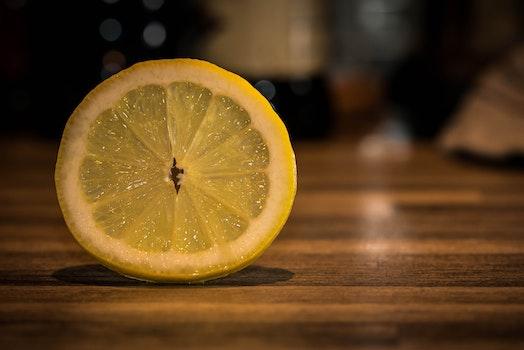 Sliced Lemonade on Brown Wooden Surface