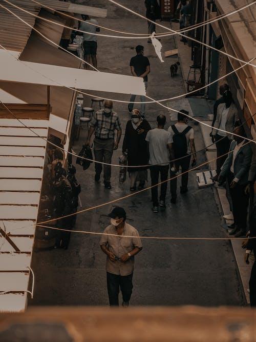 Local ethnic people in masks walking on bazaar