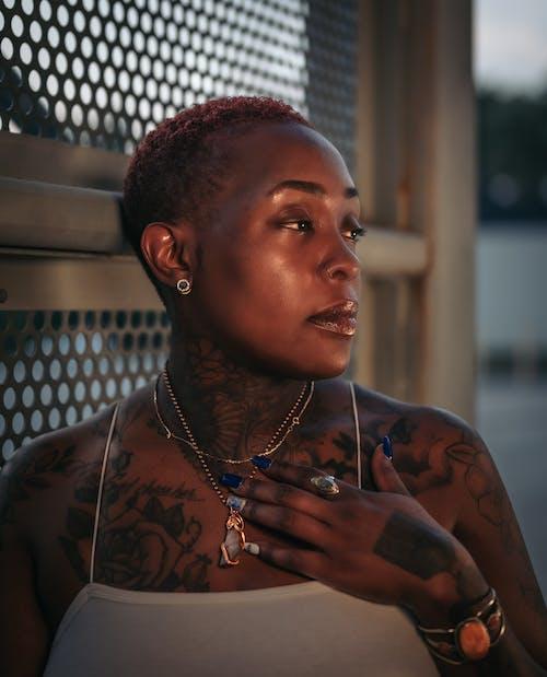 Skin Head Woman with Tattoo
