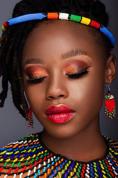 A Close Up of a Woman Wearing Make Up