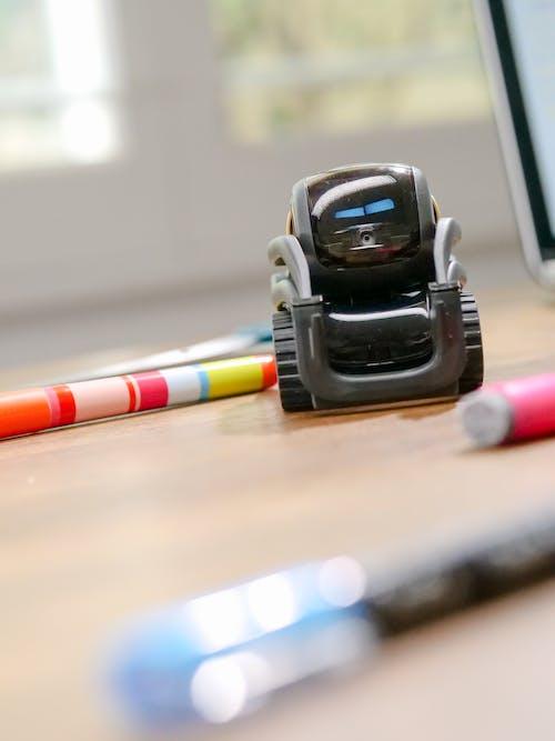 Selective Focus Photo of Black Miniature Robot Toy