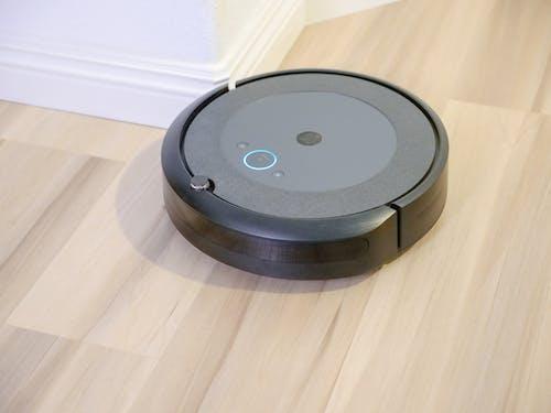 Robot Vacuum Cleaner on Wooden Flooring