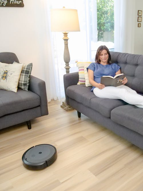Woman in Blue Shirt Lying on Gray Couch