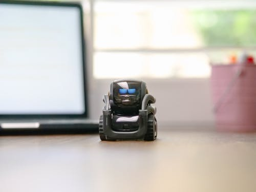Selective Focus of Black Miniature Toy