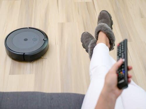 Black Vacuum Cleaner on Wooden Flooring