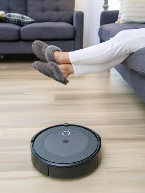 Black Vacuum Cleaner on Hardwood Floor