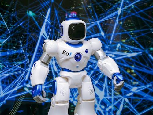 White Robot Action Figure on Blue String Lights