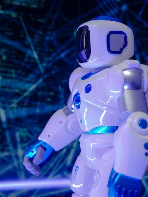 White and Blue Illuminated Toy Robot
