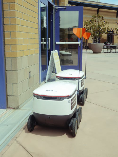 Delivery Robots Beside Building