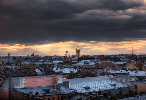 Aerial View Of Cityscape Under Dark Clouds