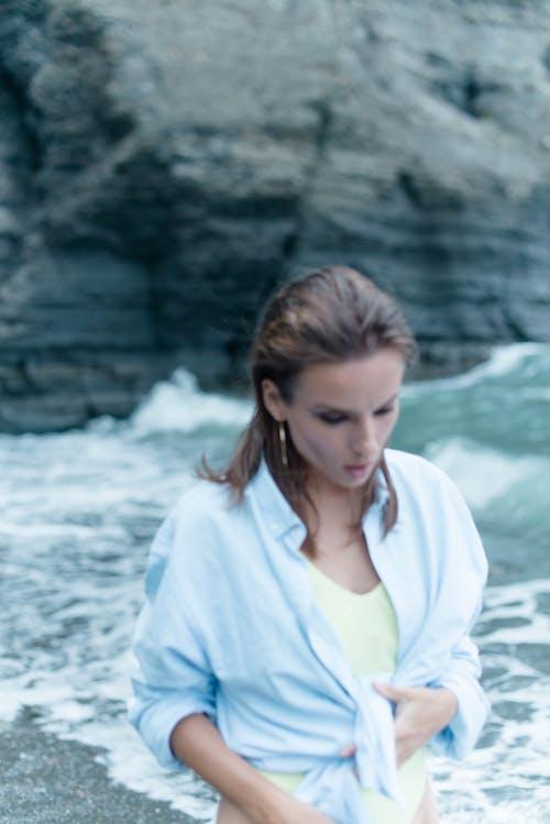 Woman in White Dress Shirt Standing Near Body of Water