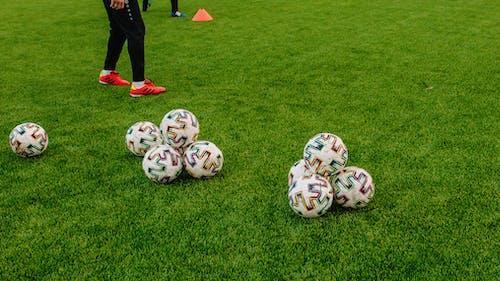 Set of Balls on Green Grass Field