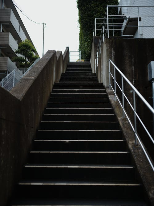 Low Angle Photography of a Concrete Staircase