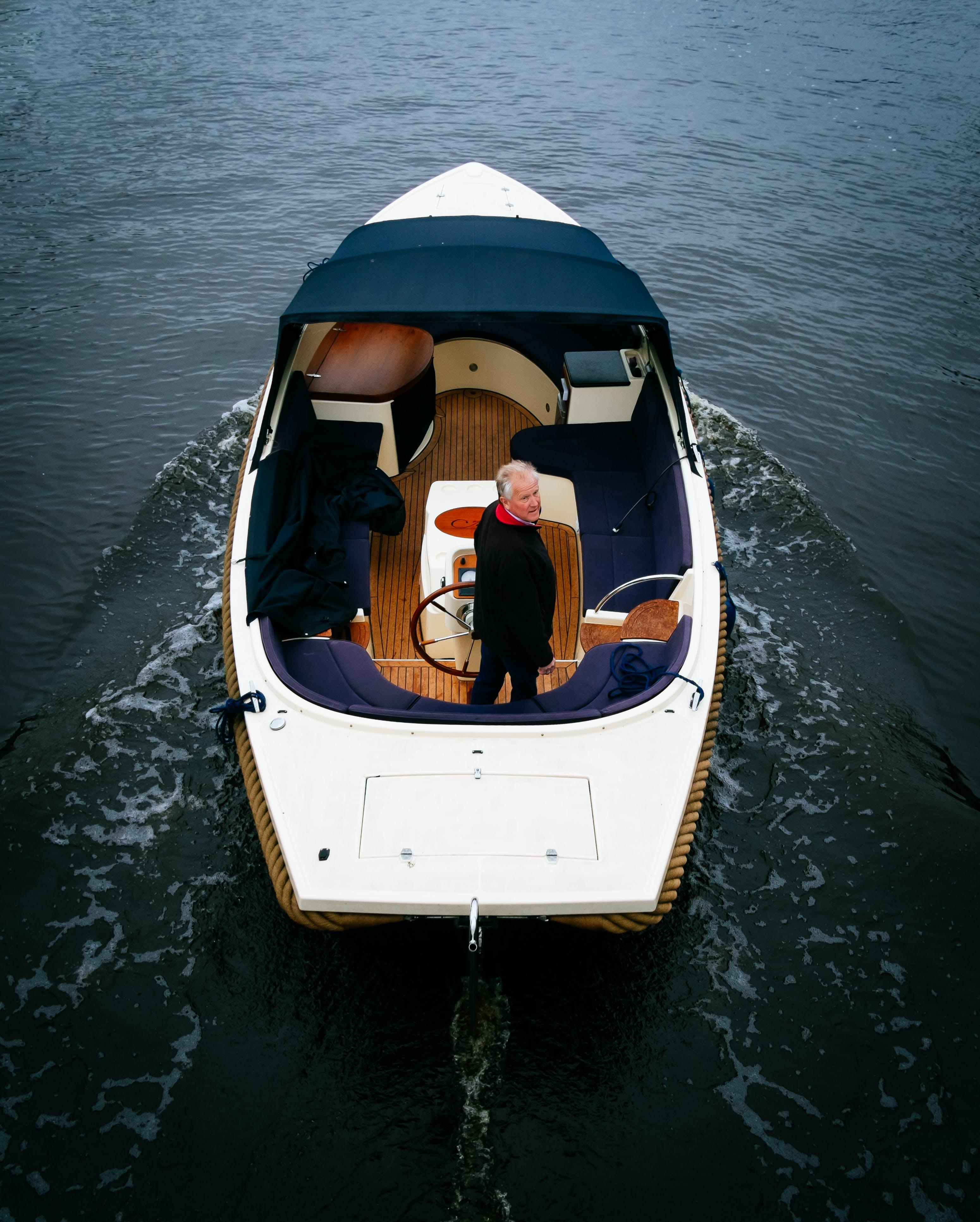 Free stock photo of sea, man, boat, ship