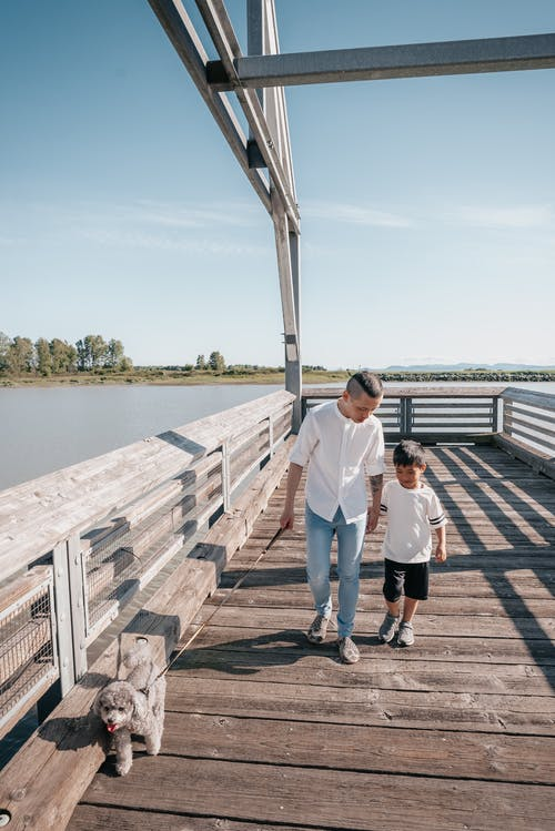 Dad and Son Walking Together on a Boardwalk