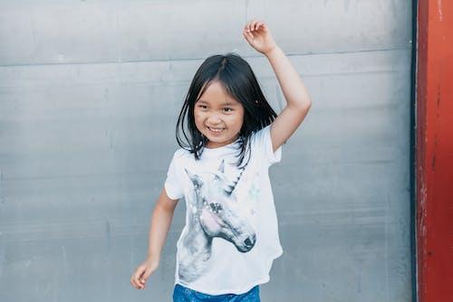 Smiling Girl in White Shirt