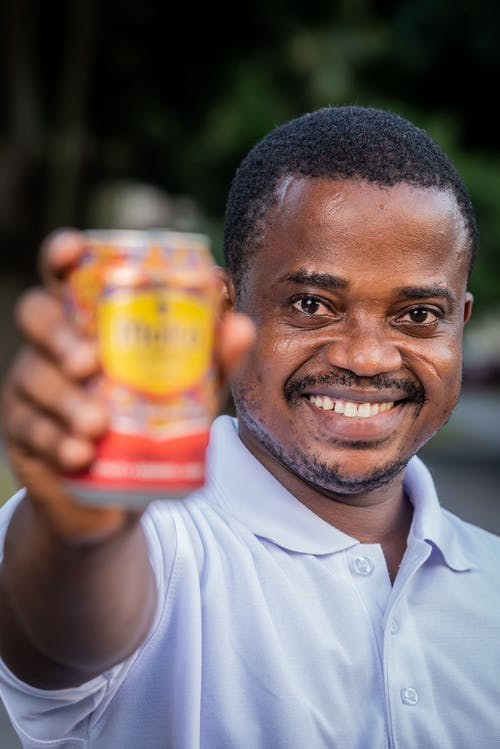 Man Holding a Can of Drink Into Camera