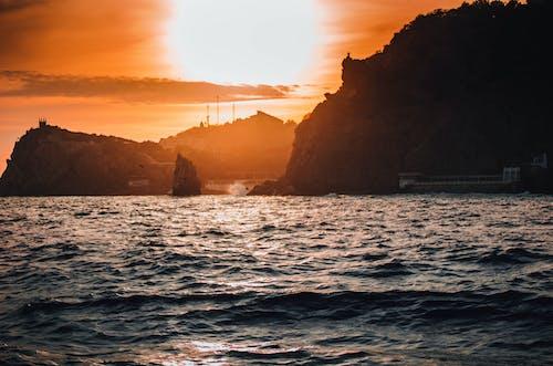 Бесплатное стоковое фото с багровое небо, закат, море