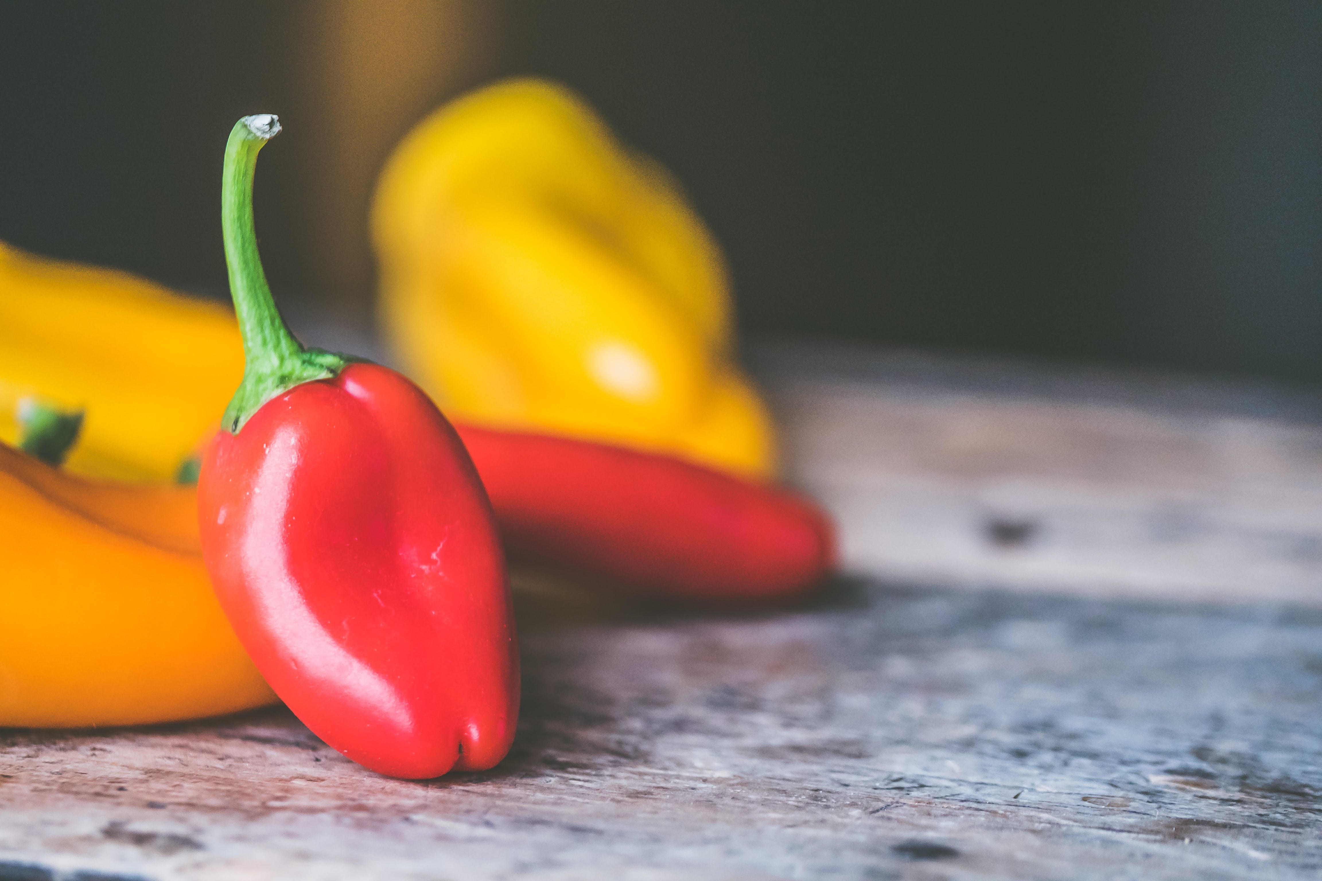 Red Chili Pepper on Gray Wooden Surface