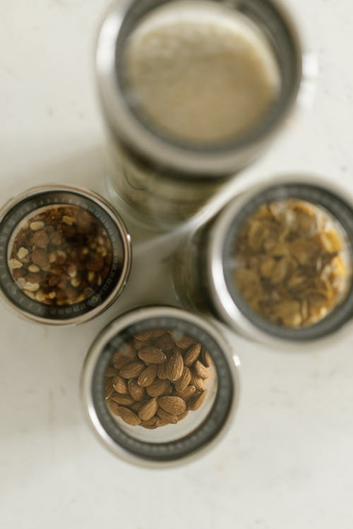 Different Kinds of Nuts in Glass Jars