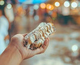 Bokeh Photo of Person Holding Shanghai Roll Wraps With Mayonnaise