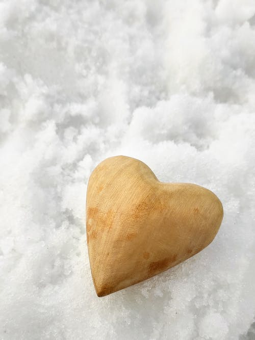 Brown Heart Shaped Stone on White Snow