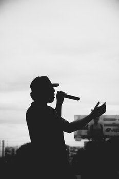 Silhouette of Man Singing