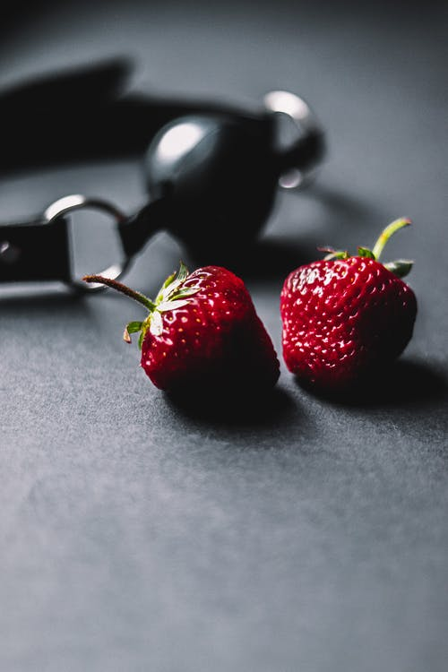 Red Strawberries on a Black surface