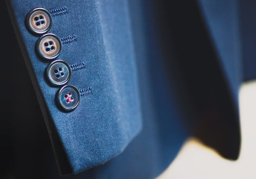 Shallow Focus Photography of Black Button on Formal Suit Jacket Sleeves