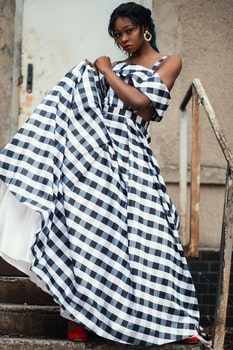 Photo of a Woman Wearing Gingham Dress