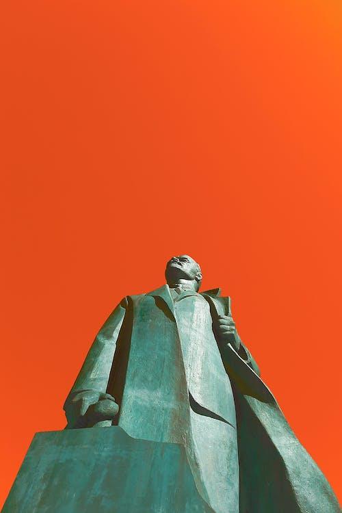 Man in Brown Coat Statue