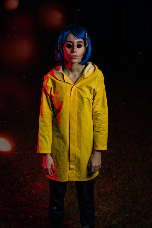 Woman in Yellow Jacket Standing