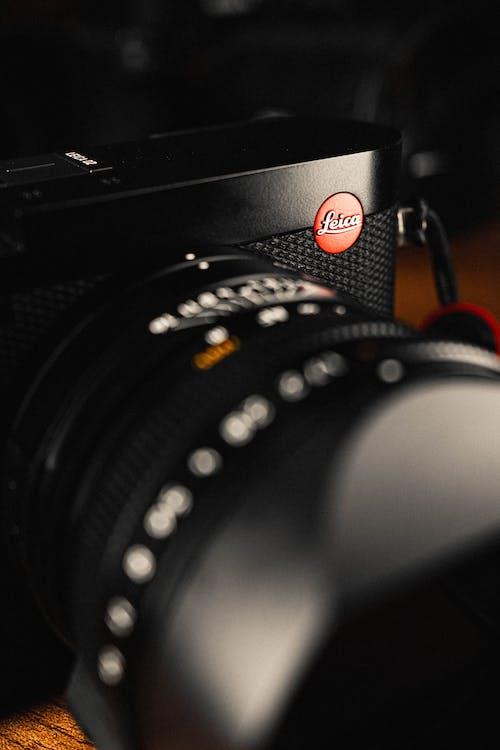 Black Nikon Camera Lens on Brown Wooden Table
