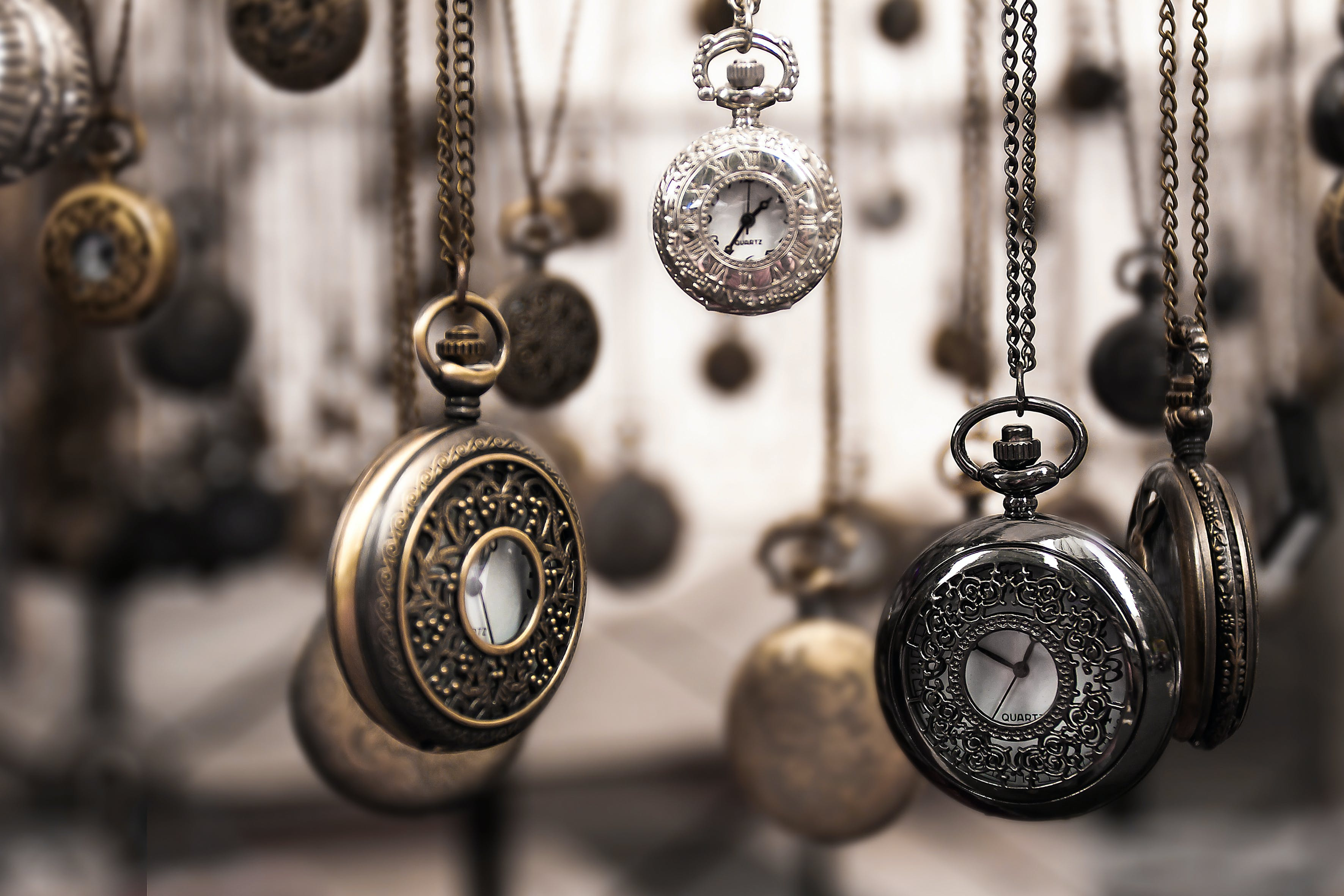 Assorted Silver-colored Pocket Watch Lot Selective Focus Photo