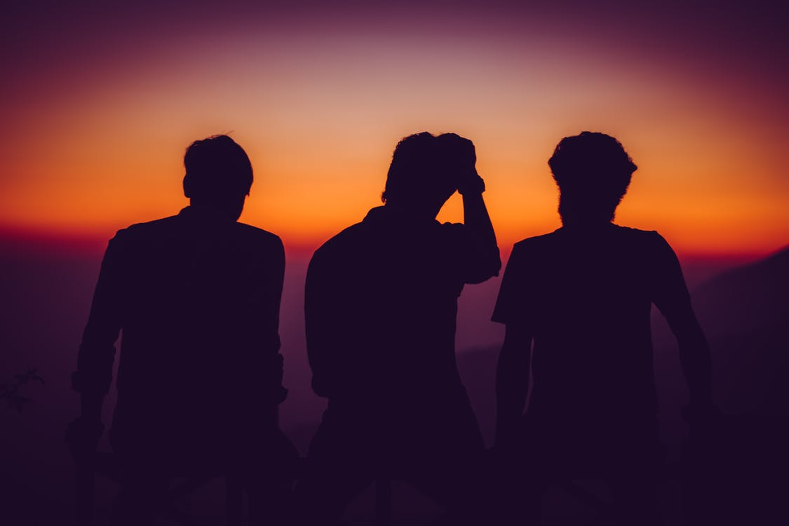 Silhouette of Men Standing on Open Area Golden Hour Photography
