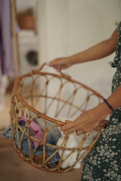 Close-Up Shot of a Person Holding a Woven Basket