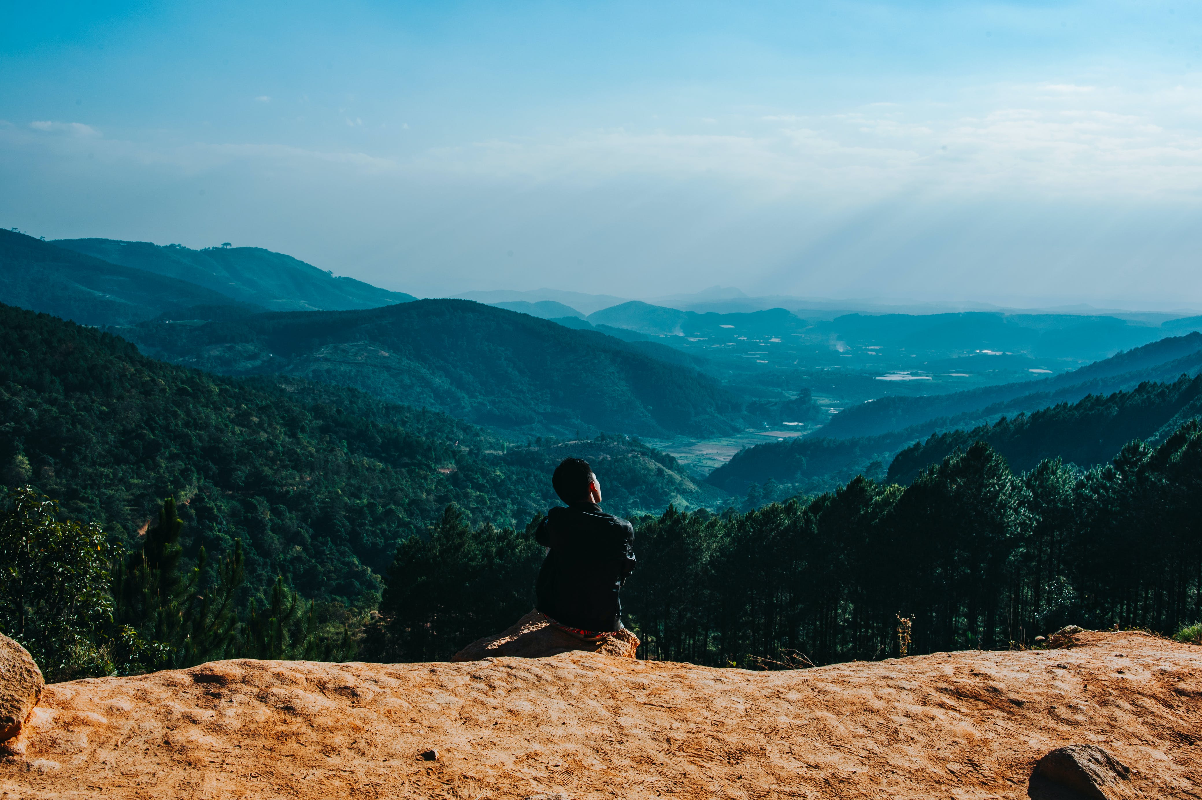 Person Sitting By The Cliff