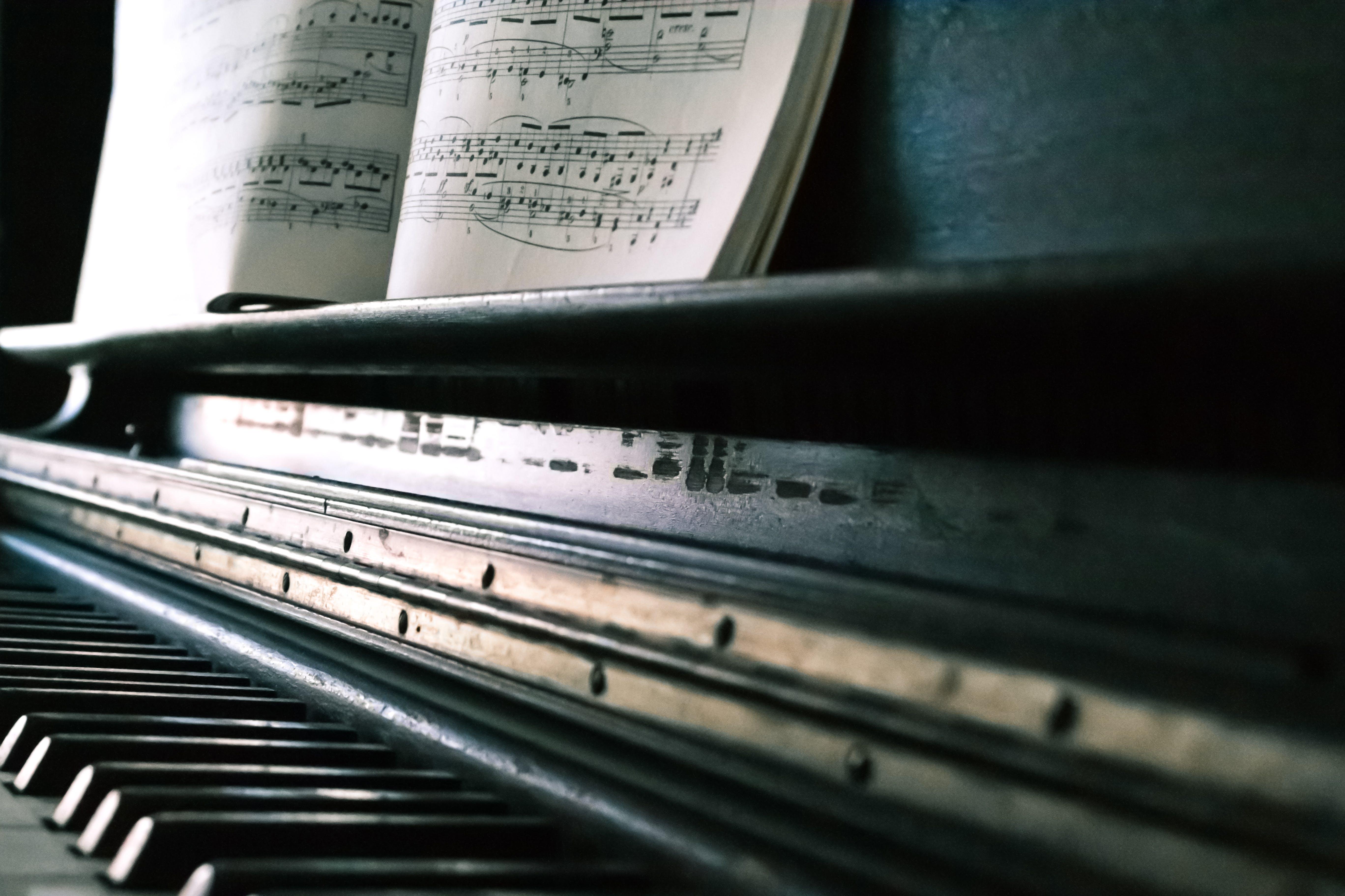 Music Sheet on Black Piano
